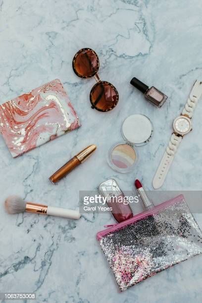 top view of set female accessories on marble  pink flat lay - personal accessory stock pictures, royalty-free photos & images