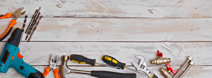 top view of set of hand tools on wooden background with copy space, suitable for header or banner 1127113169