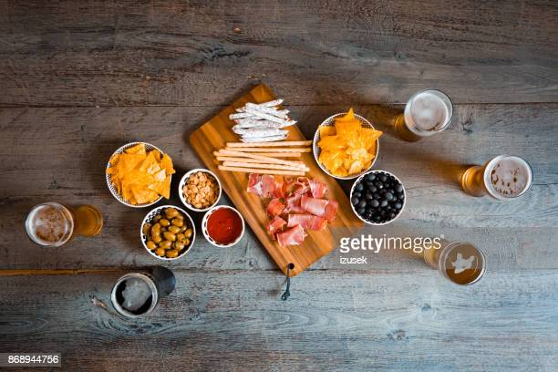 top view of table with beer glasses and snacks - snack stock pictures, royalty-free photos & images