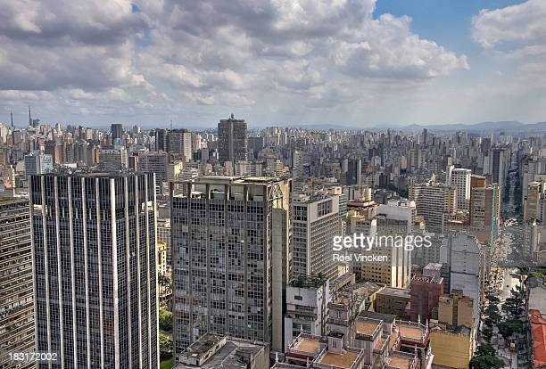 CONTENT] Top view of the many skyscrapers and buildings in the densely built business district of São Paulo Seen from the Edificio Altino Arantes...