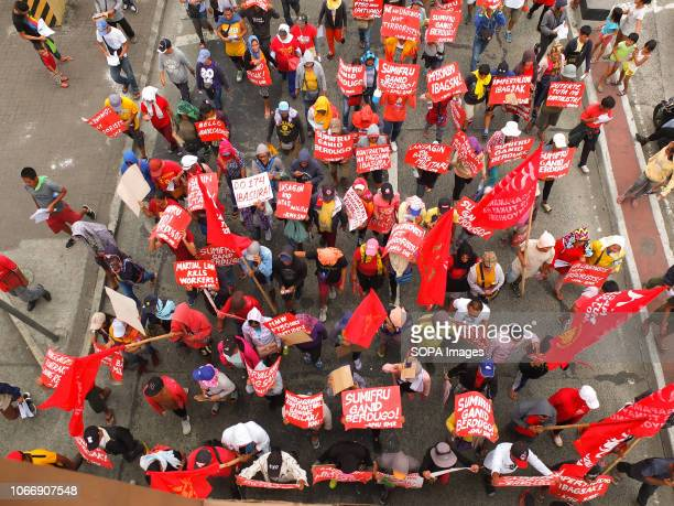 Top view of the Militant protesters holding placards and flags during the protest Leftist groups stage Bonifacio Day of protest in Mendiola and at...