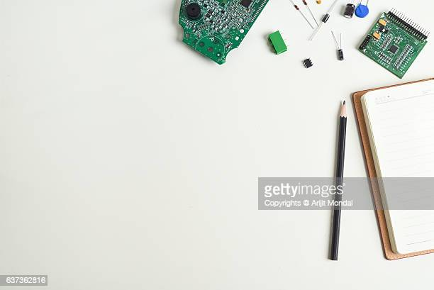 Top view of the working desk of electronic manufacturing plant with PCB assembly, electronic components with copy space