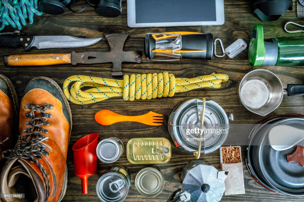 Top view of travel equipment and accessories for mountain hiking trip on wood floor : Stock Photo