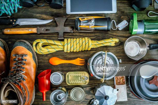 top view of travel equipment and accessories for mountain hiking trip on wood floor - gear stock pictures, royalty-free photos & images