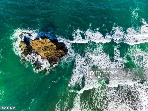 Top View Of Whatipu Lighthouse and Sea Waves Breaking.