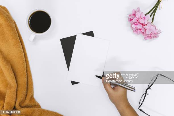 top view of woman hand writing on invitation card - handwriting stock pictures, royalty-free photos & images