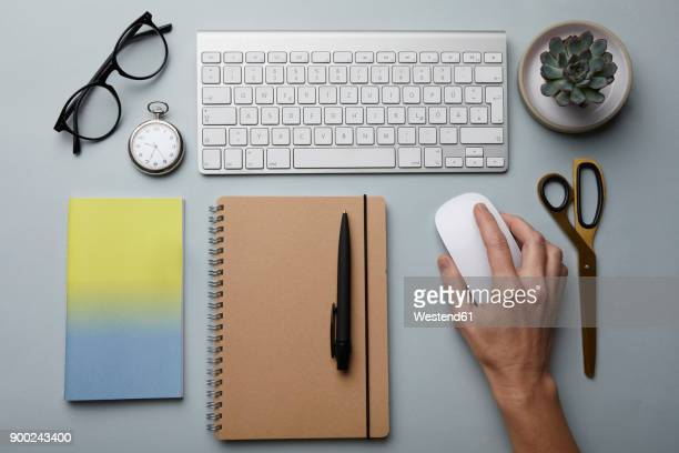 top view of woman using computer mouse on desk - neat stock pictures, royalty-free photos & images