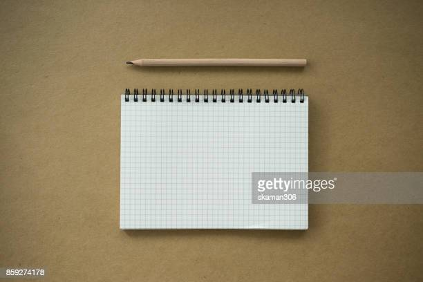 top view of wooden color pencil with notepad