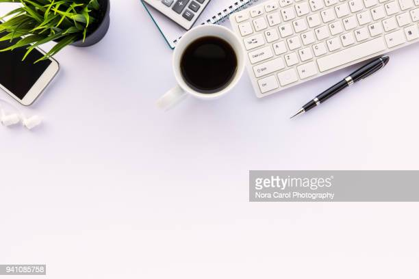 top view of workspace on white background - on top of stock pictures, royalty-free photos & images