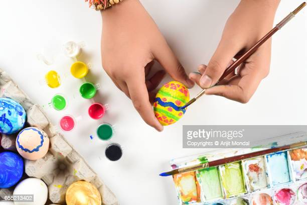 Top View of Young Boy Colouring Real Animal Easter Eggs