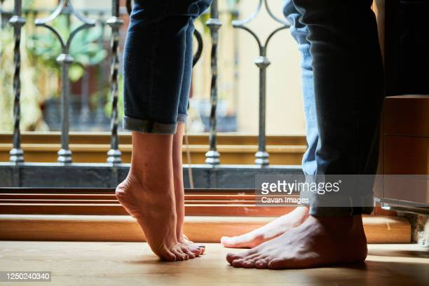top view of young intimate couple relaxing next to a window with a balcony at home. - trousers stock pictures, royalty-free photos & images