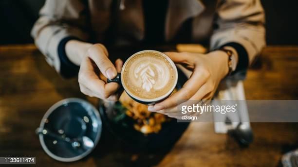 top view of young woman having a relaxing time enjoying meal with coffee in a cafe - caffeine stock pictures, royalty-free photos & images