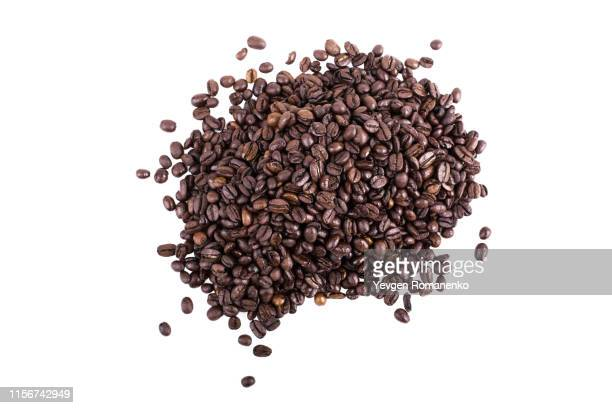 top view on a heap of fresh roasted coffee beans on a white background - mocha stock pictures, royalty-free photos & images