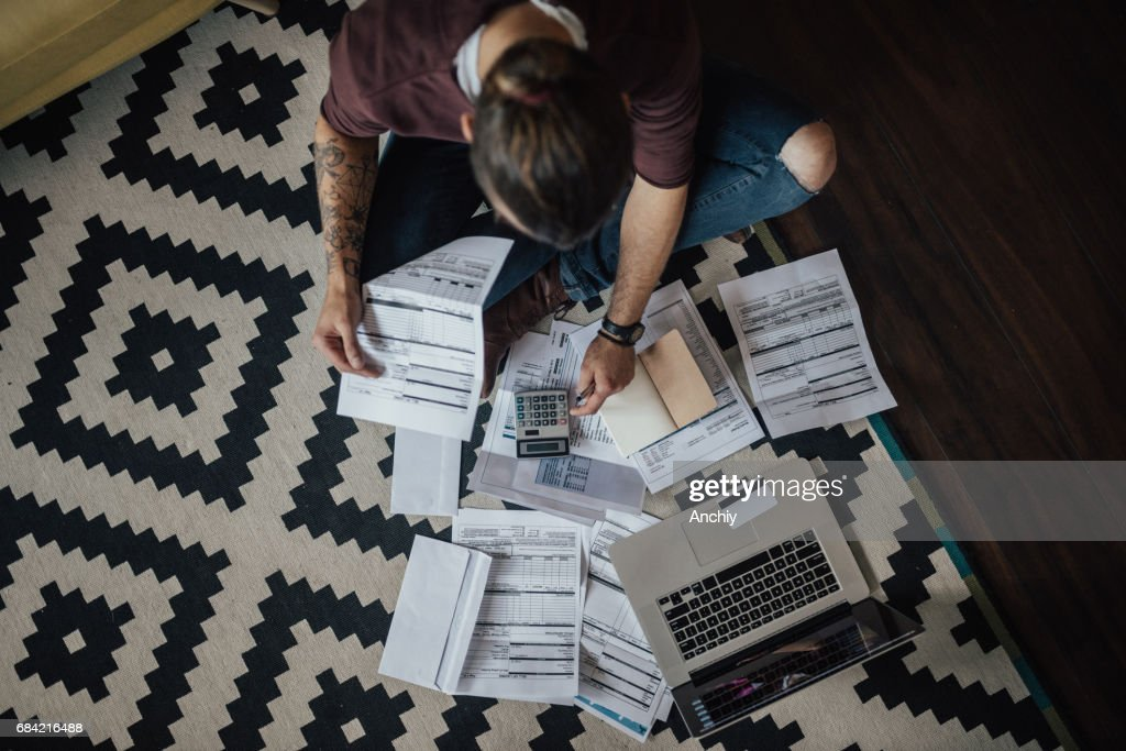 Top view on a student with bunch of overdue bills : Stock Photo