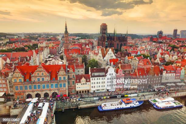 top view on gdansk old town and motlawa river, poland at sunset. - motlawa river stock pictures, royalty-free photos & images