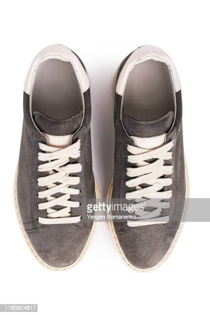 top view on grey suede sneakers shoes on white background, directly above view - loafers stock pictures, royalty-free photos & images