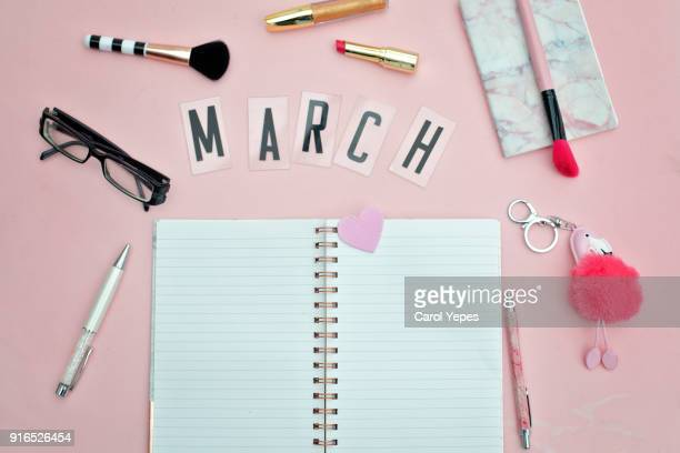 top view open blank notebook pen and eyeglasses with march message - march month stock pictures, royalty-free photos & images