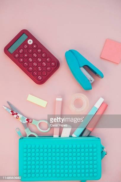 top view school supplies in pink pastel tones - schulbedarf stock-fotos und bilder