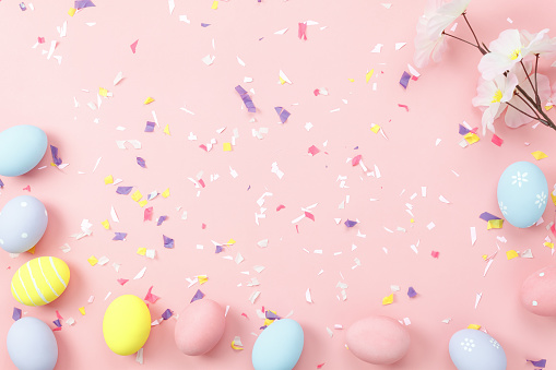 Top view shot of arrangement decoration Happy Easter holiday background concept.Flat lay colorful bunny eggs with accessory ornament on modern beautiful pink paper at office desk.Design pastel tone. 921976152