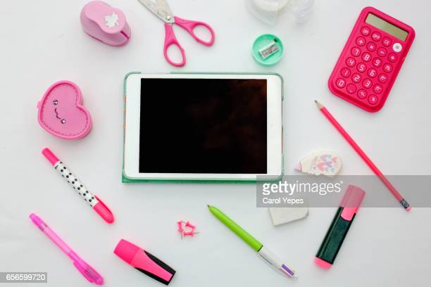 top view tablet and school supplies