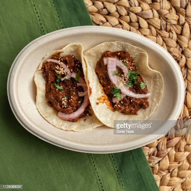 top view two tacos - mole sauce stock pictures, royalty-free photos & images