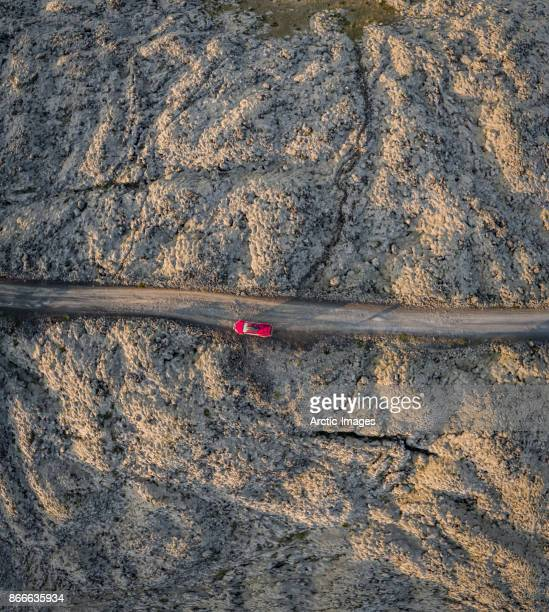 Top view-Lava formations, Road and Red Car