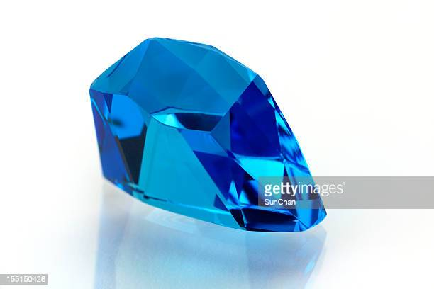 topaz or aquamarine in free form - topaz stock photos and pictures