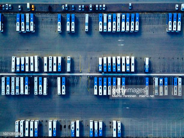 top-down aerial view into a bus depot in helsinki - bus stock pictures, royalty-free photos & images