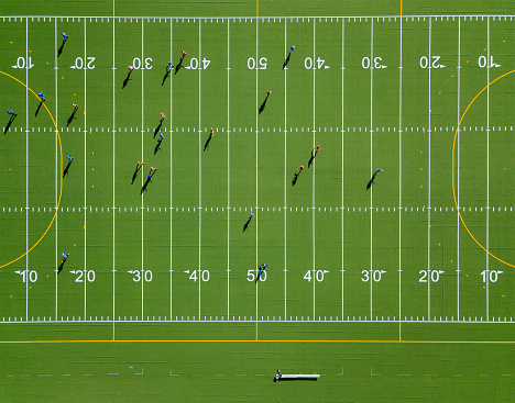 Top-down aerial view onto a green american football field with players - gettyimageskorea