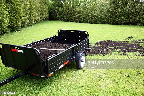 topdressing lawn - trailer stock pictures, royalty-free photos & images