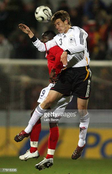 Tope Obadeyi of England goes up for a header with Holger Badstuber of Germany during the U19 international friendly match between Germany and England...