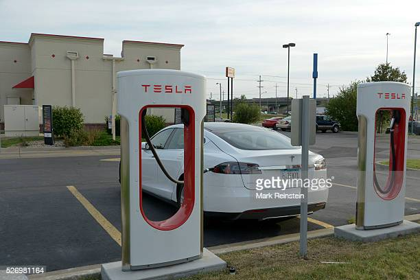 Topeka Kansas 952015 Tesla Model S is plugged in and charging at the supercharger station in the Arby's parking lot in Topeka Kansas Tesla...