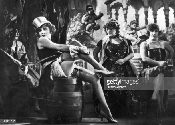 A tophatted Marlene Dietrich performs in a nightclub scene from the German expressionist film 'Der Blaue Engel' directed by Josef Von Sternberg for...