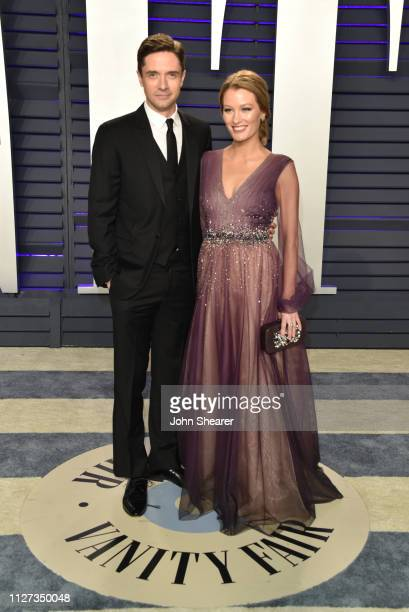 Topher Grace and Ashley Hinshaw attend the 2019 Vanity Fair Oscar Party hosted by Radhika Jones at Wallis Annenberg Center for the Performing Arts on...