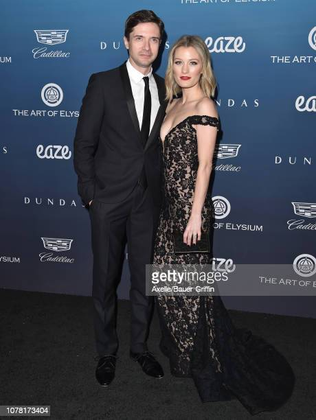 Topher Grace and Ashley Hinshaw attend The Art of Elysium's 12th Annual Celebration Heaven on January 5 2019 in Los Angeles California