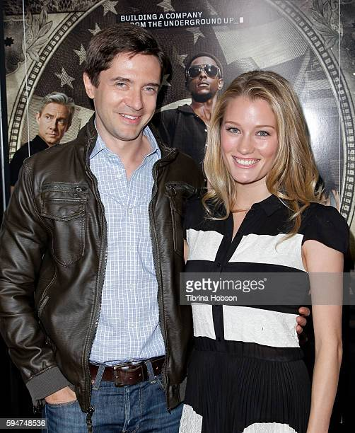 Topher Grace and Ashley Hinshaw attend the premiere of Crackle's 'Startup' at The London Hotel on August 23 2016 in West Hollywood California
