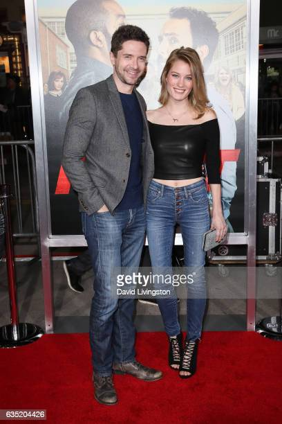 Topher Grace and Ashley Hinshaw attend the premiere of Warner Bros Pictures' 'Fist Fight' at Regency Village Theatre on February 13 2017 in Westwood...