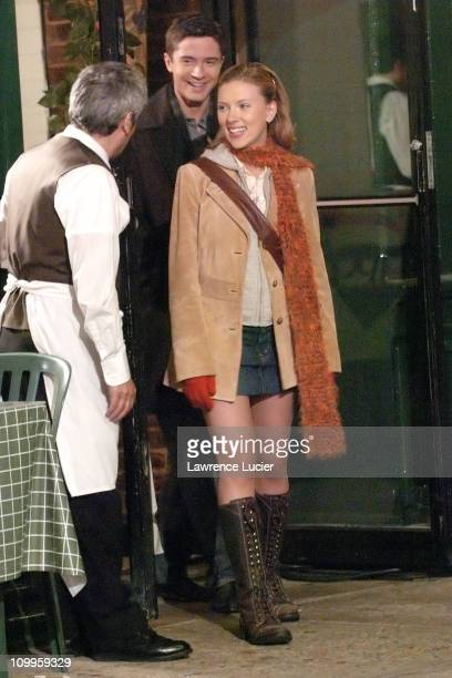 Topher Grace and Scarlett Johansson during Scarlett Johansson and Topher Grace on the Set of Synergy May 20 2004 at Little Italy in New York City New...