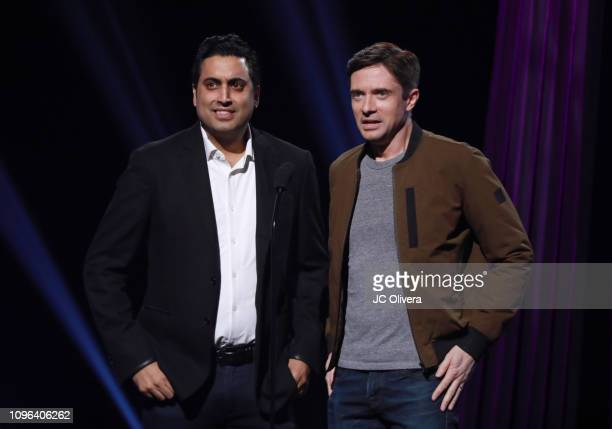 Topher Grace and Sim Sarna speak onstage during the 2019 iHeartRadio Podcast Awards Presented By Capital One at iHeartRadio Theater on January 18...