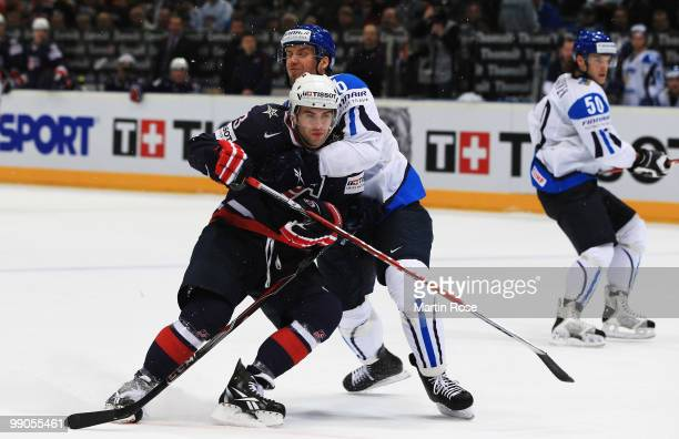 Topi Jaakola of Finland and Keith Yandle of USA battle for the puck during the IIHF World Championship group A match between Finland and USA at...