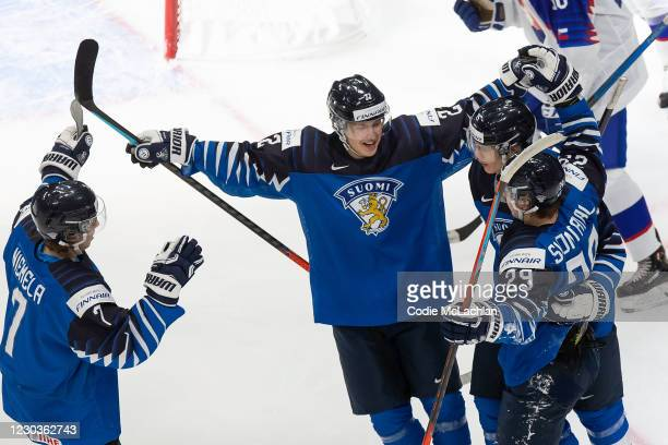 Topi Niemela, Roni Hirvonen, Anton Lundell and Kasper Simontaival of Finland celebrate a goal against Slovakia during the 2021 IIHF World Junior...