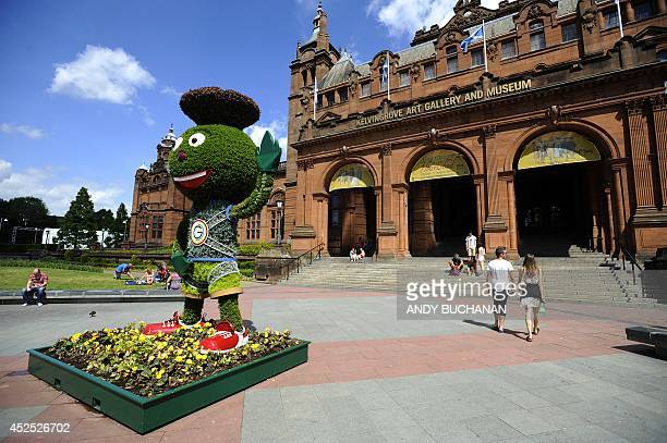 A topiary rendering of the 2014 Commonwealth games mascot Clyde Thistle is displayed outside Kelvingrove Museum and Art Gallery next to the Lawn...