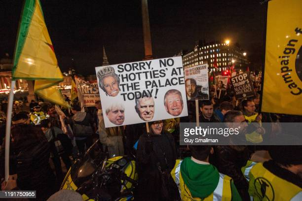 A topical placard about Prince Andrew and Donald Trump at Trafalgar Square on December 3 2019 in London England A number of different political and...