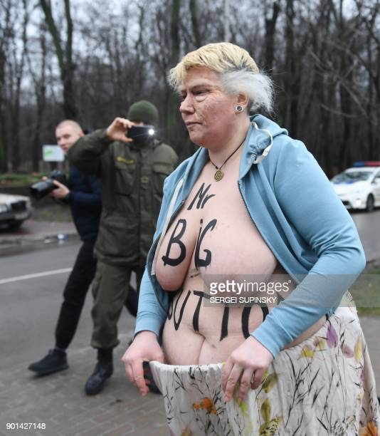 A topless activist of the Ukrainian women's movement Femen maked up as US President Donald Trump and with an inscription on her body reading 'Mr Big...