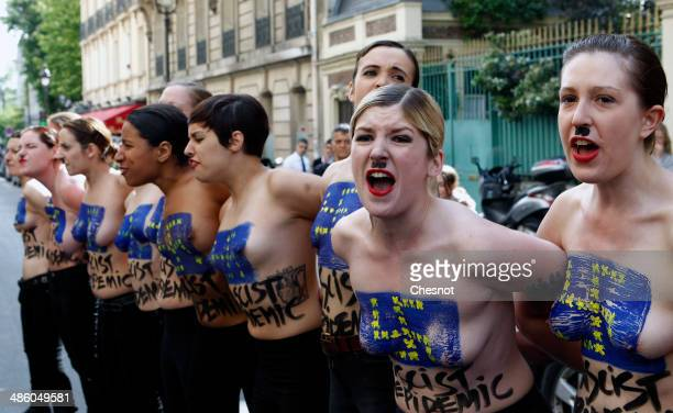 Topless activists of the feminist movement Femen demonstrate during a 'Fascist's Epidemic' protest with the aim of disturbing a press conference of...