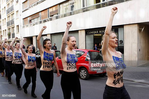Topless activists of the Ukrainian women movement Femen demonstrate during a 'Fascist's epidemic' protest to disturb a press conference of French...