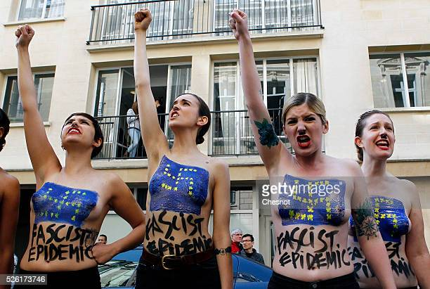 Topless activists of the Ukrainian women movement Femen demonstrate during a Fascist's epidemic protest to disturb a press conference of French...
