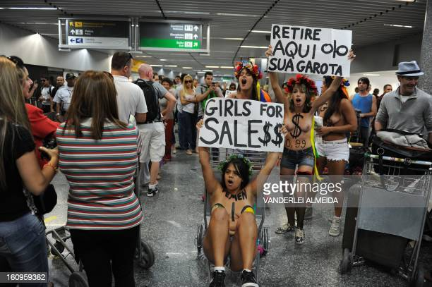 Topless activists of the women's rights group Femen Brazil stage a protest at Rio de Janeiro's international airport Tom Jobim on February 8 2013...