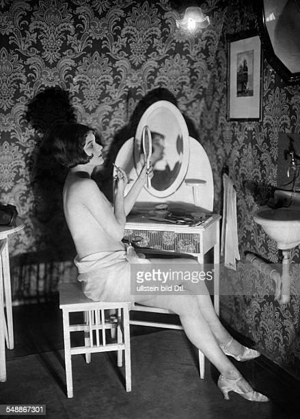 Topless dancer from a Charellrevue in her wardrobe applieying some makeup 1925 Photographer Zander Labisch Published by 'Uhu' 03/1925/26 Vintage...