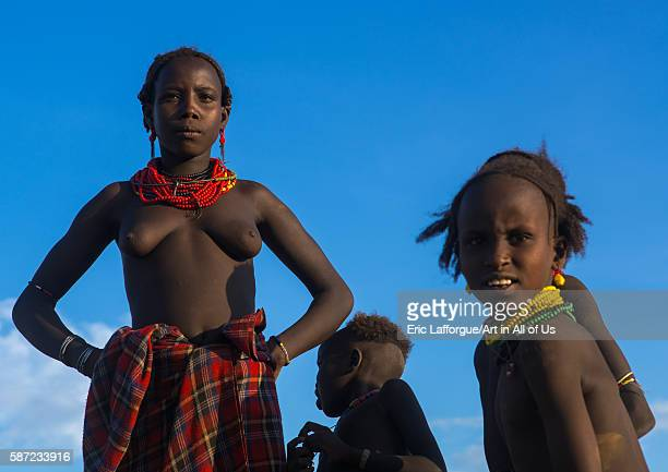Topless dassanech tribe woman and children omo valley omorate Ethiopia on March 16 2016 in Omorate Ethiopia